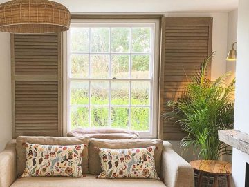 Premium hardwood shutters installed in a farmhouse