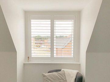 Plantation shutters for dormer windows